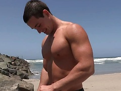 Muscled stud Dominic plays with his rock hard cock