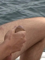 Starting out in his swimming trunks and basking in the summer warmth, Scott's cock is quickly on display and being lovingly stroked by BlakeMason image #5
