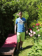Tattooed Peter Jules masturbating outside in the yard. by BF Collection image #6