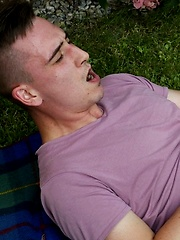 Joshua Czech lays a blanket down outside and busts a nut. by BF Collection image #8