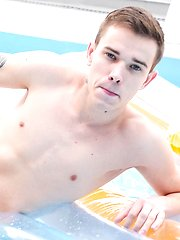 Russian twink Vitali Kutcher floats in the pool with a hard cock. by BF Collection image #8