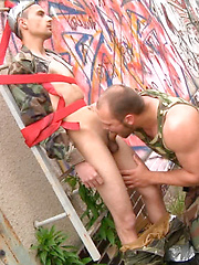 Dude gets tied up & spanked & fucked by Gay WarGames image #17