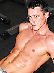 Hot stud posing in a gym