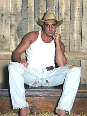 Marcello wearing cowboy hat oils his firm body and masturbates