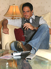 Marcello relaxes with a glass of red wine and his firm cock in his hand