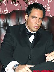 Marcello smoking a cigar in his tuxedo and then rubbing his hard dick