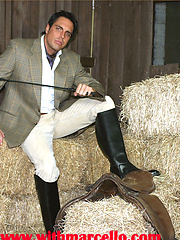 Marcello dressed in full riding suit masturbating in the stables