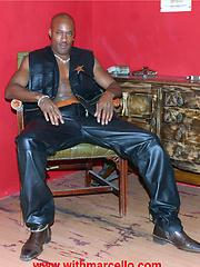 Gay black stallion wearing leather pulls his huge erection hard