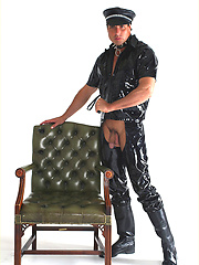 Horny Marcello wearing a pvc outfit and showing his cock and feet