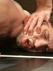 Two naked hot studs battle it out in a wild match that ends with a hard fuck and leaves everyone satiated and covered with cum.
