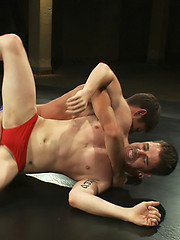 Two newcomers battle it out in an oil match to see who will submit and get fucked.