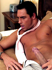 Hunky Marcello takes off his suit and plays with his huge cock