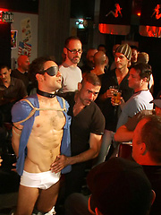 Hot stud gets fucked and cum on his face at a public bar.