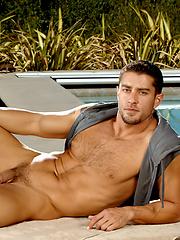 Cody Cummings posing by the pool
