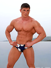 Hot muscle hunk shows his boner outdoors