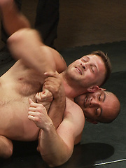 Four hot muscle studs in an aggressive tag team match in front of a live audience. Winners celebrate by fucking, fisting and DPing the losers!