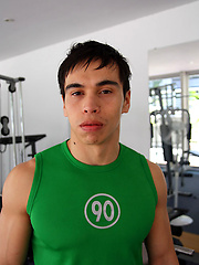 Young jock shows his sixpack in a gym