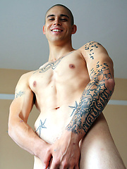 Tattooed stud shows his abs and fat cock