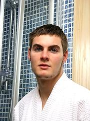Dan posing in a shower