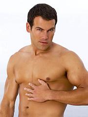 Muscled man Jason Ridge posing naked outdoors