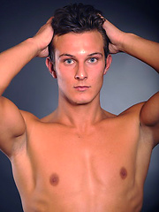 Hot brunette stud posing naked and shows his butt