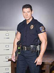 Police officer Robert Van Damme stripping