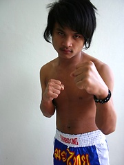 Cute gay Thai kickboxer posing and stripping