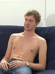 His long uncut cock slowly rises up and his boxers come down