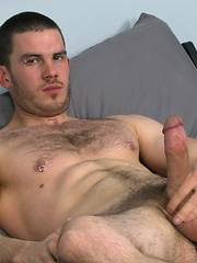 Muscled hairy stud strokes his dick
