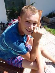 Cute czech boy posing naked outdoors