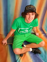 cute skater teen boy with long hairs