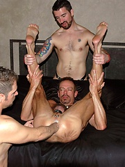 16 photos of  muscular and hung guys in a 3-way fisting binge