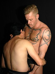16 photos of a Hot Tattood man opening up his buddy\\\'s hole and giving it a good fisting