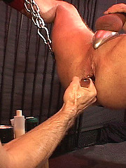 HDK Cum fisting pig gets his hole gaping!