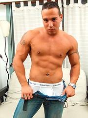 Muscle hunk John strokes his dick