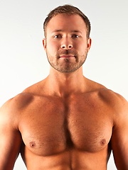 Austin Wolf is one horny New Yorker who loves playing with his hungry hole as much as he loves spurting a load of hot jizz all over his furry chest.