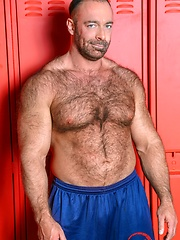 Hairy muscle man Brad Kalvo shows his cock
