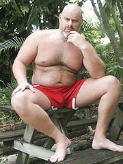 Hairy bald chubby bear Brick Hampton outdoors