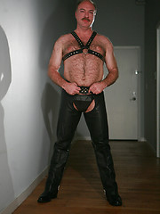 Jeremy Todd in a lether gear strokes his uncut mature cock