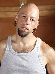 Bald punk Budd Cort shows his tattooes and cock