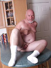 Bald daddy bear Sterling Steel shows his small cock