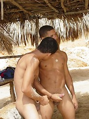 Sexy black twinks fucking bareback on the beach.
