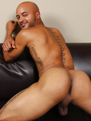 Bald ebony muscle man Simon strokes dick and shoots a load
