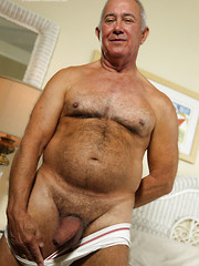 Hairy silver daddy Dick Ryan shows his fat uncut dick