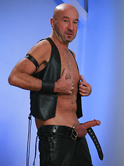 Bald mature man Mick Rock in a leather