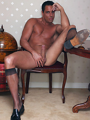 Marcello takes off his suit and tie to wank in his shiny black stockings