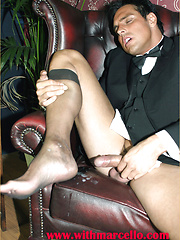 Marcello smoking a cigar in his tuxedo and then rubbing his hard dick