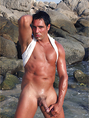 Hunky Marcello at the beach wearing a white vest and thong, and playing with his dick