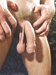 Thomas eats a peach while his uncut cock hangs out.