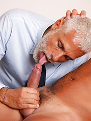 Mature daddy sucking off cock